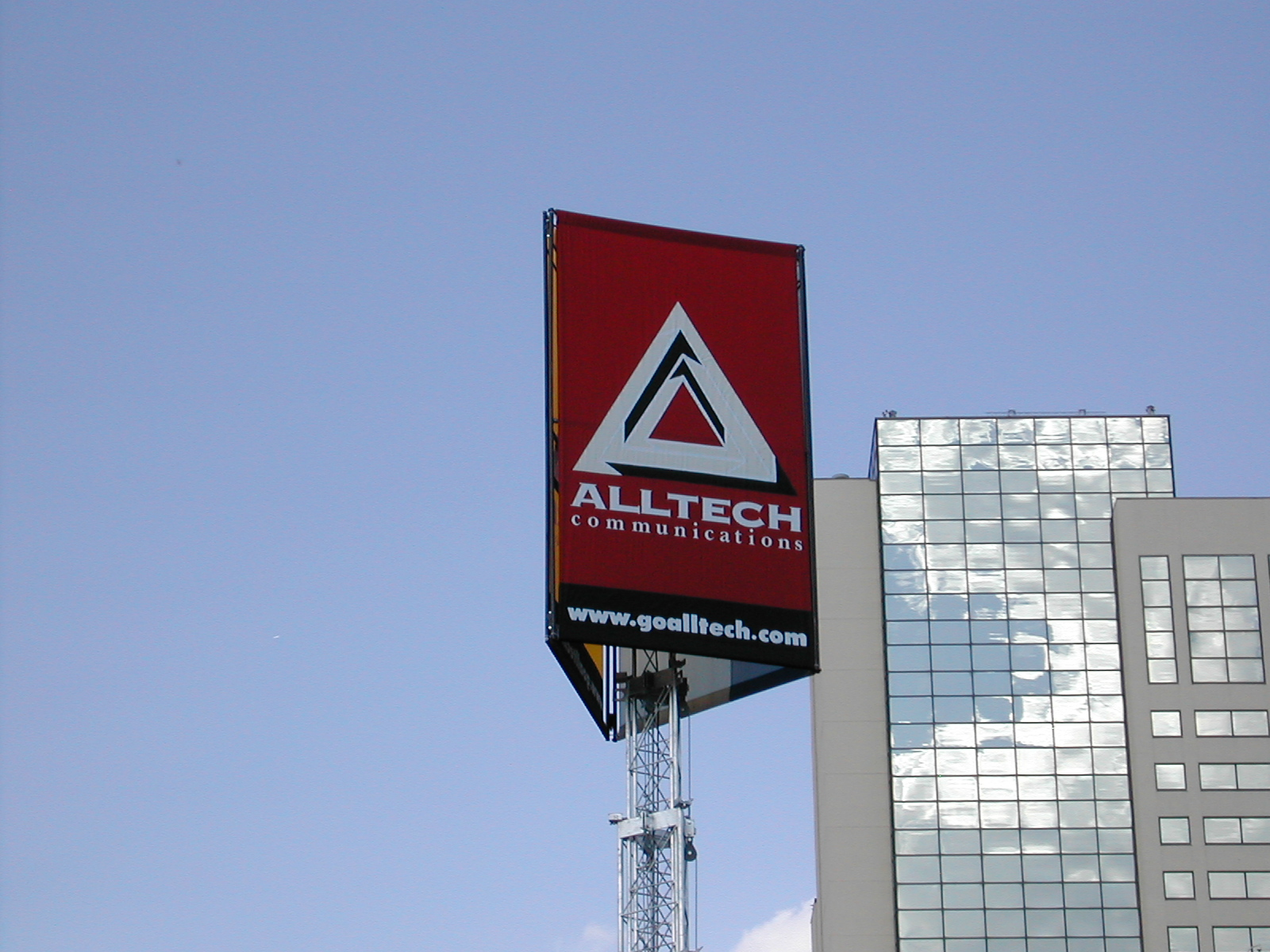 Alltech Communications flag on Mobile Tower Trailer cell on wheels with telescoping tower